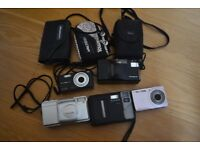 Job lot of camera`s 5 camera`s and 3 cases