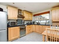 A three bedroom purpose built house with a private garden on Mayford Road - £2100pcm
