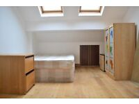 LARGE SPLIT LEVEL TWO BEDROOM APARTMENT LOCATED BETWEEN SOUTHFIELDS AND EARLSFIELD STATIONS