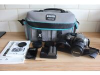 Canon Silver EOS 300D with ef-s 18-55mm Zoom Lens.