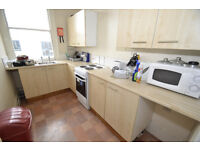 A double room with its own en-suite shower room and W.C , sharing kitchen facilities.