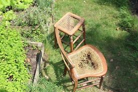 A cane seated chair and stool for restoration