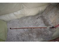 a full sized wooden viola bow
