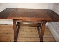 Solid Oak Dining Table seats 4, add leaves to seat up to 8 people. Table top needs a little work