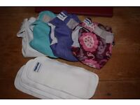4 reusable all in one nappies with boosters