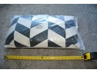 hamstead chevron cushions (black and cream) still in wrappers.