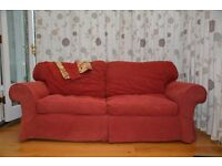 Three-seat sofa with extra set of covers