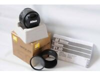 Nikon 50mm 1.8D autofocus lens in mint condition with lens hood and filter.