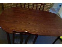 Dining table with 4 chairs, sturdy, VGC, room to add two more chairs.