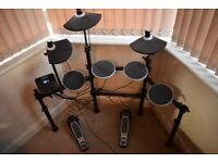 Full size electric drum kit, lights up when you play and teaches you to play, used about 6-7 times.