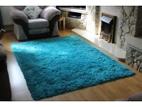 two rugs, colour teal for sale