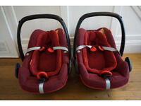 Pair of Maxi-Cosi Pebble Plus baby car seats with new newborn inserts