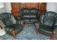 Green leather sofa and armchairs