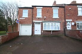 Well-presented and extended 3 bedroom end terraced house with garage.