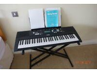 Yamaha EZ220 electric keyboard.