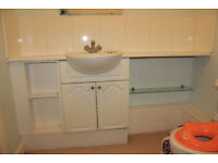 Washbasin with cupboard and large desk