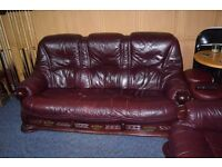Leather and wood Three and two seat sofa.