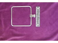 A standard 150 mm square towel ring for bathroom in chrome.