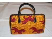 Uniquely Beautiful handmade Ladies Ankara bags and purses. Made for any occassion.