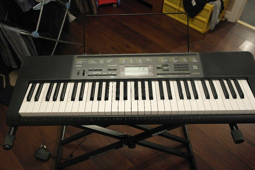 Casio 61 Key Piano style keyboard with stand