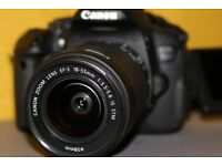 Canon 700D DSLR Camera with 18-55mm kit lens PLUS additional zoom lens (75-300mm) AND spare battery