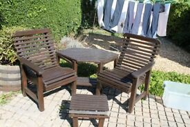Solid wooden garden table and chairs with footstool