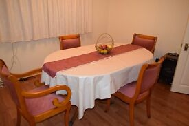 Solid dining room table & 4 chairs