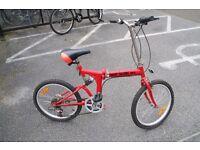 Finsby folding bike with helmet