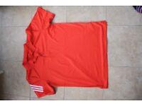 Unworn Adidas Golf polo shirt size M in orange