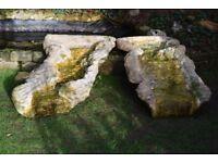 A pair of rock effect fibreglass pond waterfalls.