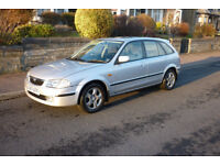 Mazda 323 1.8L GT. Nice clean condition.