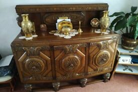 Hand carved oak sideboard, dining table and chairs
