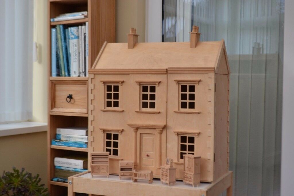 Two storey Georgian style dolls house with wide range of furniture