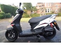 Kymco Agility RS 125, as new apart from 3 minor scuffs shown in pictures