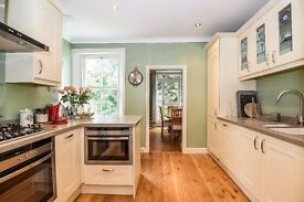 STUNNING LARGE FAMILY HOME WITH PRIVATE GARDEN SITUATED WITHIN MOMENTS OF HIGHGATE VILLAGE
