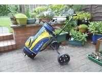 Childs golf bag, trolley , clubs.