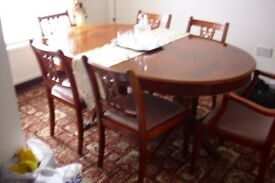 Mahogany Dinning room table and 6 chairs.