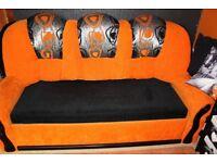 Orange /black sofa bed with storage