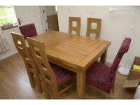 RUSTIC OAK EXTENDING DINING TABLE AND SIX CHAIRS