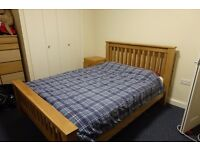 Solid oak double bed (Julian Bowan) with 3000 pocket sprung mattress