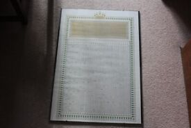 Framed print of a miniature version of the entire koran print glass front