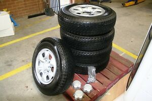BRIDGESTONE TYRES AND ORIGINAL STEEL RIMS HILUX D/CAB 4WD