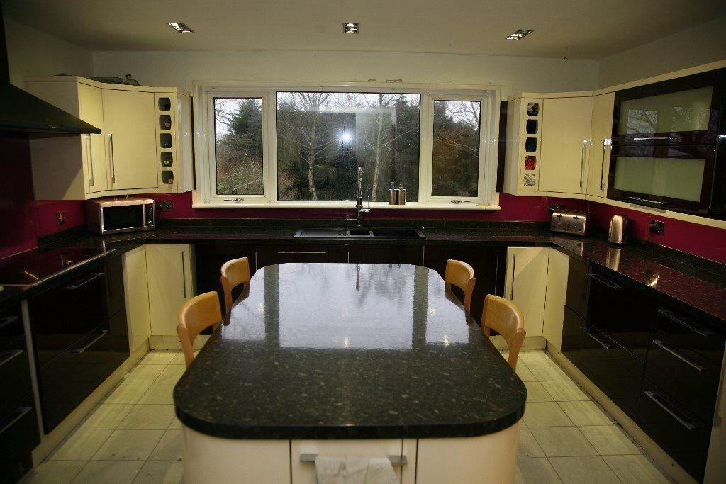B q cooke lewis kitchen in high gloss aubergine cream for Aubergine kitchen cabinets