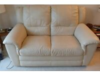 2 seat sofa in cream leather in excelent condition (bought from beales)good reason for sale