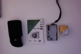 Canon Ixus Elph APS camera. Not digital. With instructions, cover with belt loop, and a film.