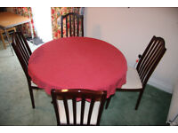 Round dinning room table and four chairs.
