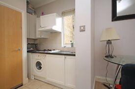 A first floor studio flat with a good size living area