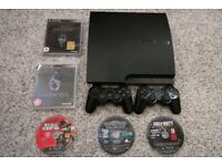 PS3 with 2 controllers and 5 games 160 gb