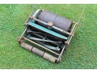 Classic Rollmo Presto push combined cut & roll grass lawnmower with grass box.