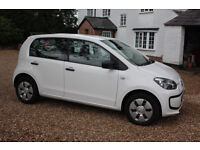 VW UP. Five doors, 60mpg, cheap tax and insurance.